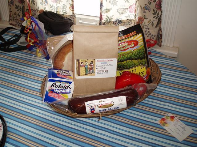 The coolest gift basket ever. Vollwerth's salami, Twin Lakes Java, gouda, crackers, a cream cheese kringle, yougurt trail mix, a