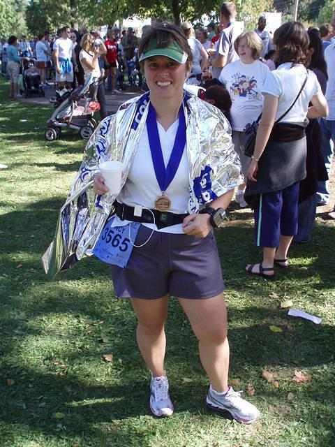 At the finish line with my medal, space blanket and water.
