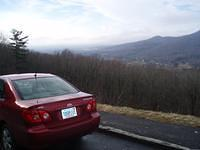 The valley, past our trusy rental car. Asheville, NC can be seen in the distance.