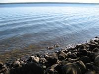 Lake Gogebic is the largest inland lake in Michgan.  Over 13 miles long, it's in 2 counties and 2 time zones.