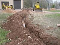 digging trench for utilities to barn