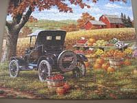 Had to buy this 500 piece puzzle because of the old car. It turned out to be a Ford.  Nice harvest time country scene.