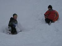 Cole & Michael slide down the hill